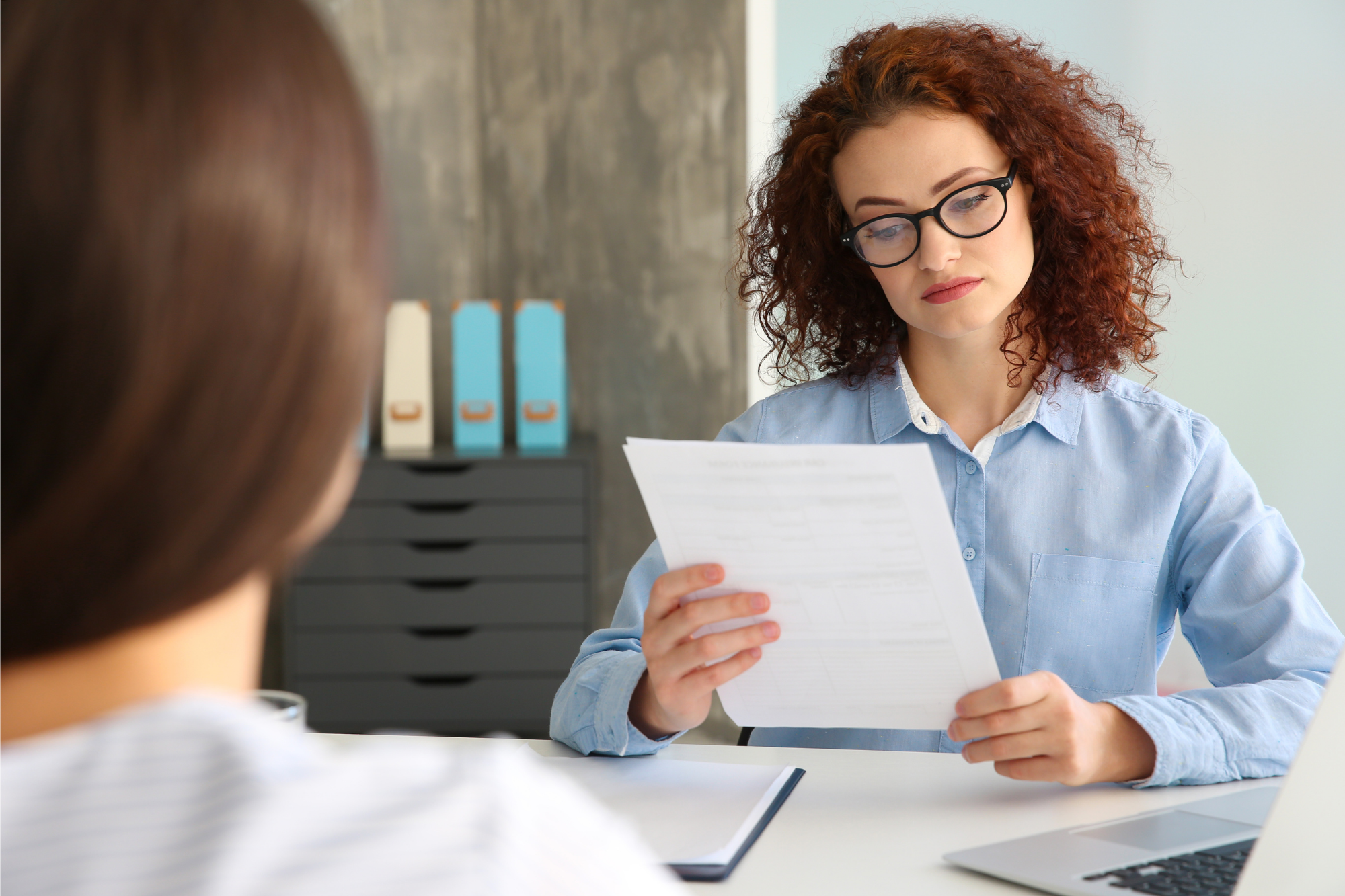 Photo of two women conducting a job interview. Alison Shamir is an Imposter Syndrome coach who can help you to conquer Imposter thoughts and nail your next salary negotiation.